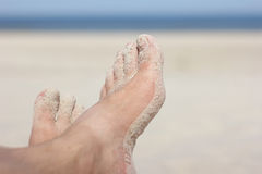 Sandy feet on the beach Royalty Free Stock Image