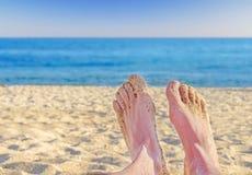 Sandy feet on the beach Stock Photo