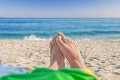 Sandy feet on the beach. Close Royalty Free Stock Image