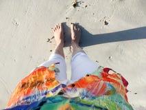 Sandy feet on the beach stock photography