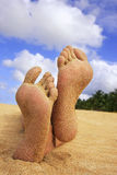 Sandy feet on a beach Royalty Free Stock Photo