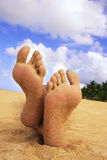 Sandy feet on a beach Stock Photo