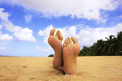 Sandy feet on a beach Royalty Free Stock Images