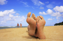 Sandy feet on a beach Stock Photos