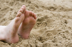 Sandy feet Stock Photos