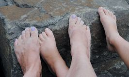 Sandy feet. Mother and daughter sandy feet Royalty Free Stock Image