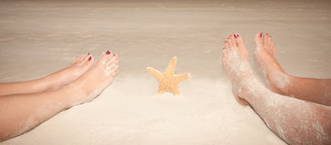 Sandy Feet With Starfish Stock Photo