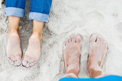 Free Sandy Female And Male Feet On The Beach Royalty Free Stock Photo - 98016595