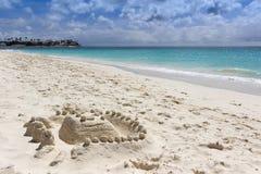 Sandy figure on Aruba beach stock images