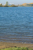 Sandy grassy shore of the lake Stock Photos