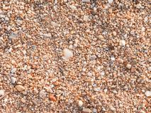 Sandy ground floor. Sandy and small stone ground floor surface background stock photo