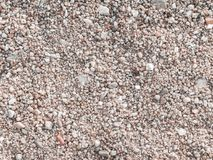 Sandy ground floor. Sandy and small stone ground floor surface background stock image