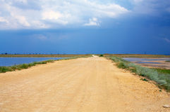 Sandy ground road between two firth lakes. Crimea Royalty Free Stock Photo