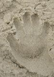 Sandy hand print Royalty Free Stock Photo