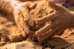 Sandy hands of a child royalty free stock images