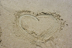Sandy Heart. A heart drawn in the beach sands Stock Image