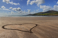 Sandy heart at the coastline Royalty Free Stock Images
