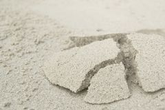Sandy hillock on the beach. Hillock from the dug-up sand on the beach in tropics royalty free stock photography