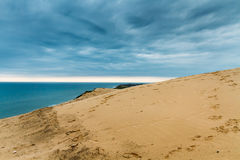 The sandy hills. Overlooking the water from the hills Royalty Free Stock Photo