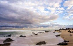 Sandy Hook Beach bij zonsondergang Stock Foto