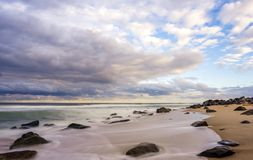 Sandy Hook Beach at sunset. Compelling clouds in the evening over the beach located in New Jersey Stock Photo