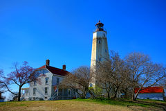Sandy Hook Lighthouse and Buildings in New Jersey. Sandy Hook historic lighthouse coastal maritime navigation aid guiding light and keepers quarters visitor Stock Images