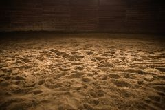 Sandy Horse Riding Arena. With Light Spot in the Middle. Rodeo Photo Background stock images