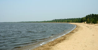 Sandy lake shore Royalty Free Stock Image