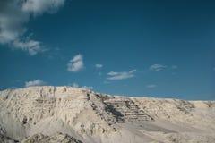 Sandy mountains. Sand quarry with white sandrn Stock Photos