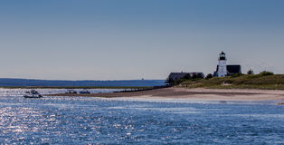 Sandy Neck Light. House near Barnstable, MA with calm seas and blue skies Stock Images