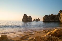 Sandy ocean beach Praia Dona Ana with famous beautiful coastal cliffs in Lagos, Algarve, Portugal royalty free stock photography