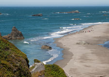 Sandy ocean beach with rock outcrops Stock Photography