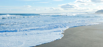 Sandy ocean coast Stock Photos