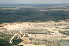 Sandy open-cast mine. Aerial view. Open-pit strip mine industrial site equipment. Aerial view. Rivne region, Ukraine Stock Photos