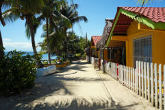 Sandy path along the sea with bungalows Stock Photo