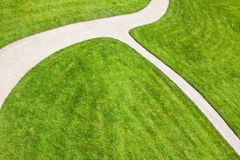 Sandy path - pavement and grass Royalty Free Stock Images