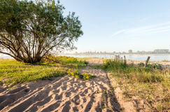 Sandy path to the bank of a river Royalty Free Stock Images
