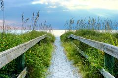 Sandy Path, Trail To The Beach. Sandy walking path, trail to the beach on a cloudy day stock photography