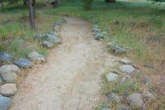Sandy Path through Woods Stock Photos