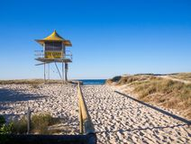 Sandy pathway entrance to the beach lifeguard tower, wooden rails Gold Coast Australia royalty free stock images