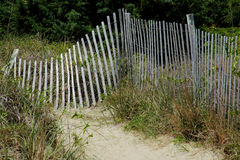 Sandy pathway past a wooden fence Royalty Free Stock Images