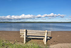 Sandy Point Beach Maine bench facing river Royalty Free Stock Photos