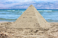 Sandy pyramid Stock Images