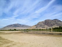 The sandy river bank of the North Thompson river in the beautiful dry landscape of Kamloops, British Columbia, Canada. stock images