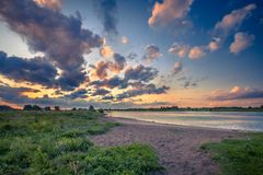 Rhine river bank at sunset. Sandy river bank of the Rhine in the national park de Blauwe Kamer in Betuwe, Netherlands at sunset Stock Photography