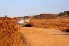Sandy road with car Stock Photography