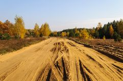 Sandy road in the country, autumn time Stock Photo