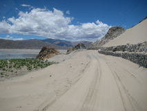 Sandy road in the mountains. Of Tibet Stock Photo