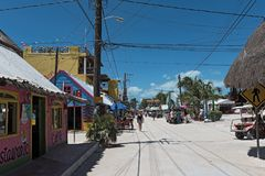 Sandy road with tourists and stalls on Holbox Island, Quintana Roo, Mexico located in north yucatan peninsula.  stock images