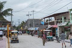 Sandy road with tourists and stalls on Holbox Island, Quintana Roo, Mexico located in north yucatan peninsula.  royalty free stock image